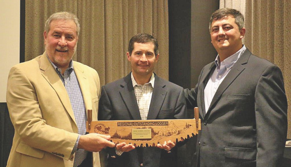 Wade Norris (center) receives FRA's Southcentral Region (SCR) Outstanding Logger Award from SCR Chairman Gary Beacher (left) and STIHL Southwest's Jude Vidrine (right).